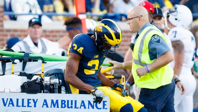 Michigan cornerback Jeremy Clark is carted off of the field after getting injured against Penn State on Sept. 24.