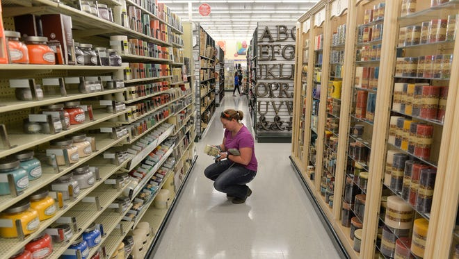 Katy Gill, St. Joseph, checks out the hundreds of candles in an aisle of the new Hobby Lobby store Friday, April 22, in Waite Park. Gill said she was driving by, noticed the cars in the lot and decided to check it out. The store had its soft opening Friday and plans a grand opening for Monday.