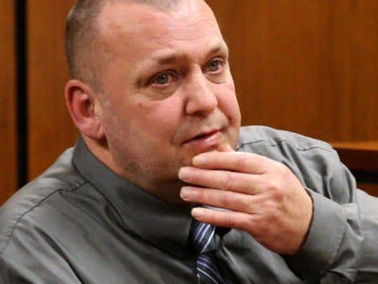 Alan Bienkowski testifies on Feb. 17, 2016 at his trial for the murder of his elderly neighbor, Anthony Verdicchio.