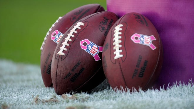 A view of footballs with pink  breast cancer awareness logos before the game between the Carolina Panthers and the St. Louis Rams at Bank of America Stadium.