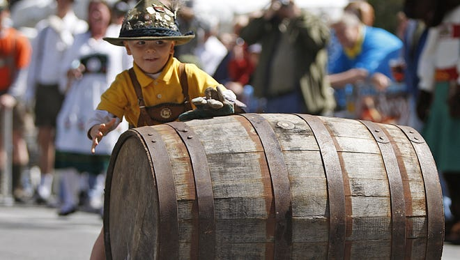 Christopher Harten steals the show before the keg races at the 2011 Oktoberfest on Fountain Square. .