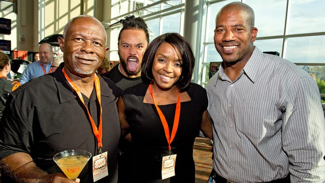 The Cincinnati Bengals hosted their annual Taste of the NFL event, a dinner-by-the-bite benefit for the Freestore Foodbank featuring chefs from the Tri-Stateâ??s top restaurants. Greg and Charisse Banks of Liberty Twp. and Bengals player rep Eric Ball of Evendale get a big Bengals photobomb from Rey Maualuga.