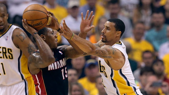 Indiana PacersÕ George Hill (3) tightly guards Miami Heat's Mario Chalmers (15) during the first half of action. The Indiana Pacers hosted the Miami Heat in Game 5 of the NBA Eastern Conference Finals Wednesday, May 28, 2014, at Bankers Life Fieldhouse in Indianapolis.
