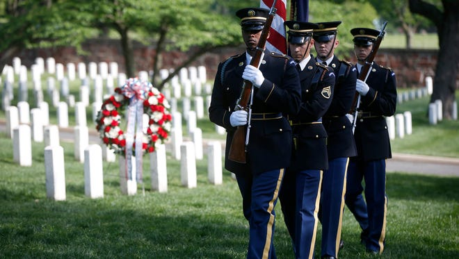 U.S. Army honor guard members march at the gravesite of Army Pvt. William Christman, who was the first military burial at the cemetery, marking the beginning of commemorations of the 150th anniversary of Arlington National Cemetery in Arlington, Va on May 13, 2014. The cemetery's hallowed ground honors American soldiers from many different wars. But as Arlington marks its anniversary this year with tours and events, historians note that its roots are firmly planted in the Civil War.