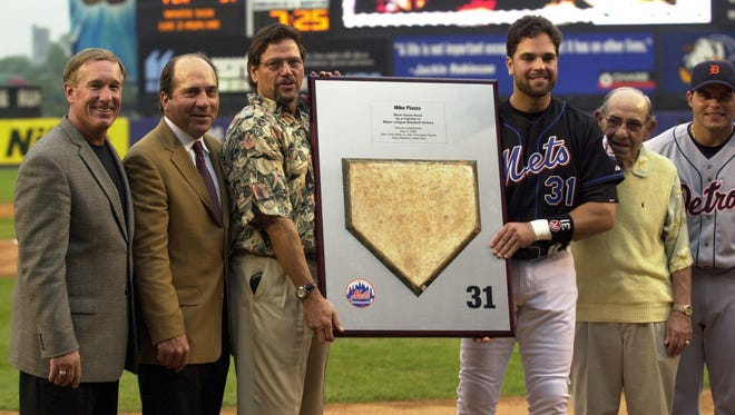 Gary Carter, from left, Johnny Bench, Carlton Fisk, Mike Piazza, Yogi Berra and Ivan Rodriguez pose for pictures after giving Mike Piazza this plaque at Shea Stadium in Flushing June 18, 2004. The Mets are celebrating Mike Piazza night in honor of his breaking Carlton Fisk's homerun record as a catcher. This was the homeplate Mike touched when he hit his record breaking 352nd homerun.