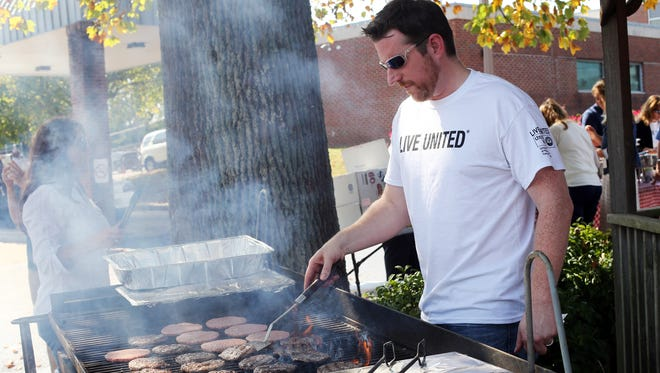 Smyrna Human Resources Director Jeff Craig flips burgers during an employee cookout to kick the town's annual United Way campaign Wednesday.
