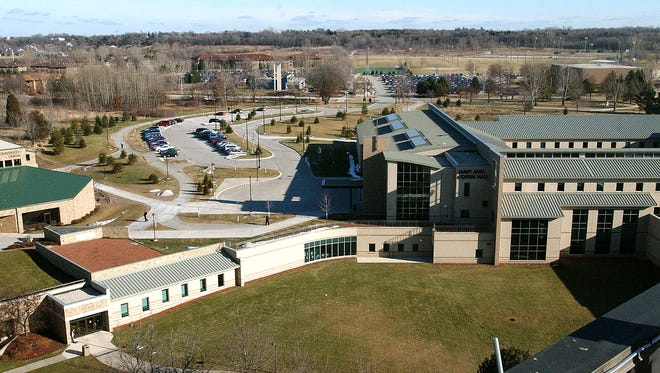 Mary Ann Cofrin Hall is at right on the UW-Green Bay campus, with tennis courts and athletic fields adjacent to the Kress Events Center in the distance. One of the alleged assaults took place in this area.