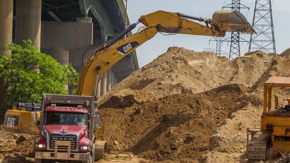 A dirt pile that may have caused structural problems with the 495 bridge over the Christina River is removed.