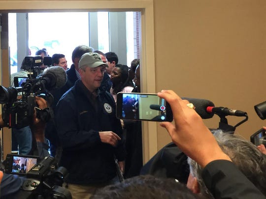 Gov. John Bel Edwards arrives in Caddo Parish for a media briefing.