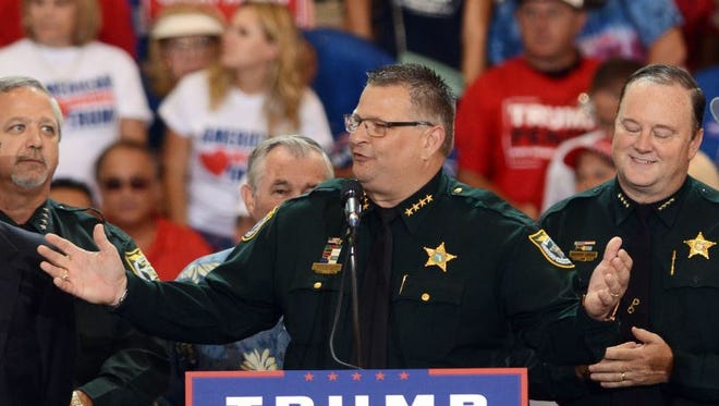Brevard County Sheriff Wayne Ivey wore his uniform while endorsing and introducing Republican presidential candidate Donald Trump at a rally Sept. 27.