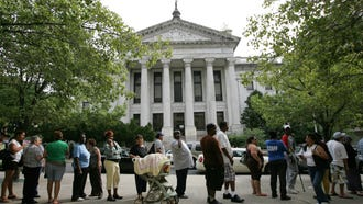 A line of applicants for food stamps outside the Passaic County Board of Social Services building in Paterson in 2011.