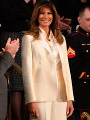 First lady Melania Trump wore a white Dior pantsuit