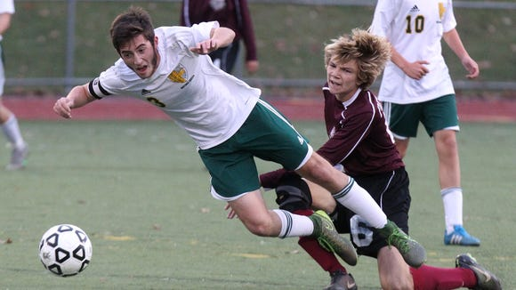 Hastings' Will Berritt is tripped by Southampton's