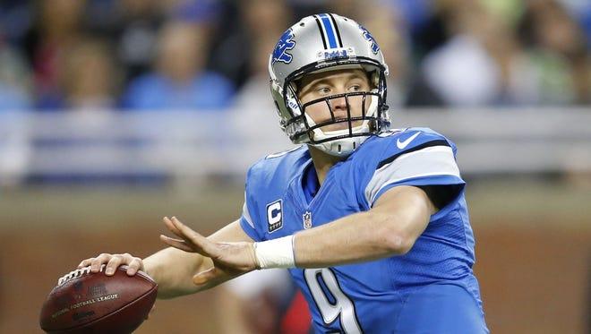 Detroit Lions quarterback Matthew Stafford passes against the New York Giants on Dec. 22, 2013.