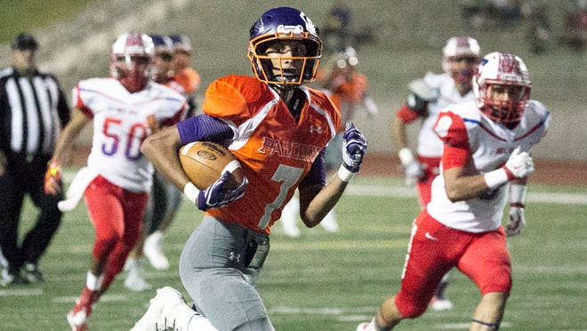 Eastlake wide receiver Emilio Rios carries the ball in for a touchdown during the first possession of the game against Bel Air Thursday at the Socorro Activities Complex.