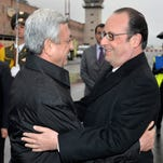 Armenia's President Serge Sarkisian, left, welcomes French President Francois Hollande at Zvartnots airport outside the capital, Yerevan, Armenia, early Friday. World leaders are attending ceremonies Friday commemorating the massacre 100 years ago of 1.5 million Armenians by Ottoman Turks. The event around the time of the World War I is widely viewed by historians as genocide. Modern Turkey, the successor to the Ottoman Empire, vehemently rejects the charge.