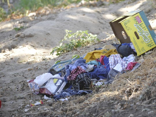 Homeless camps along the St. Johns River were vacant Tuesday morning.