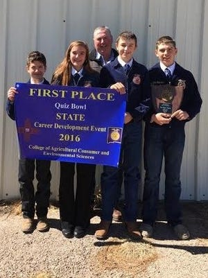 The Capitan FFA State Champion Quiz Bowl team of Blade Wilson, Andrew Renner, Andres McWilliams and Emilee Lindsay won the quiz contest for a third year-in-a-row at the New Mexico Leader Contest ion Albuquerque Feb. 5.