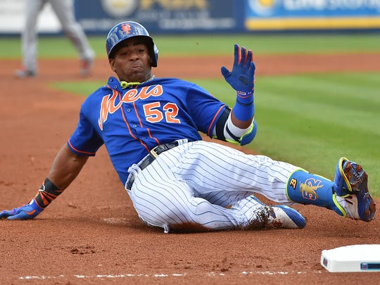 Mets left fielder Yoenis Cespedes (52) slides into third base for a triple against the St. Louis Cardinals during a spring training game at First Data Field lon Tuesday, March 28, 2017.