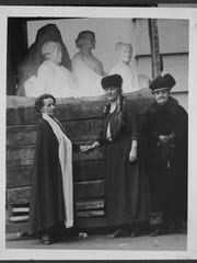 From left, Adelaide Johnson, sculptor, Mrs. Lawrence (Dora) Lewis, and Jane Addams with the Portrait Monument at the U.S. Capitol, Feb. 15, 1921.