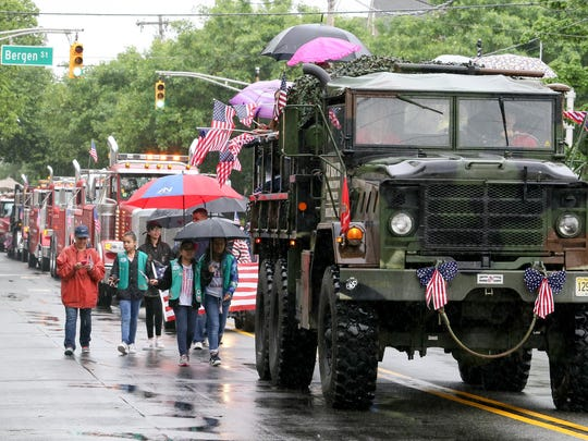 A very wet Memorial Day Parade in Dover on May 29, 2017. Alexandra Pais/ The Daily Record