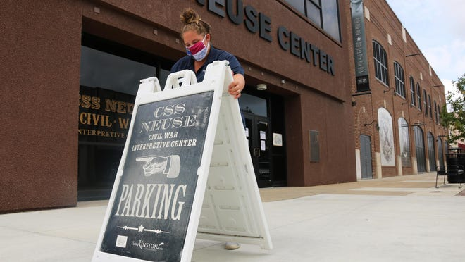 CSS Neuse Civil War Museum program coordinator Rachel Kennedy sets up the parking sign in front of the museum Tuesday morning, Sept. 8.