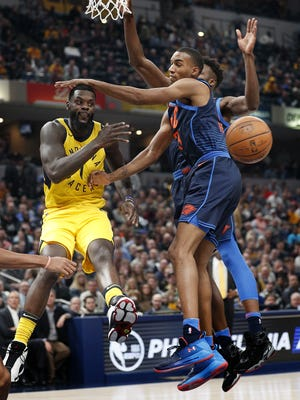 Indiana Pacers guard Lance Stephenson (1) passes the ball by Oklahoma City Thunder guard Terrance Ferguson (23) in the first half of their game at Bankers Life Fieldhouse Wednesday, Dec 13, 2017.
