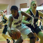 Pineville's Krystal Freeman (25, right) looks to shoot over Peabody's Asia Dorsey (5, left) Tuesday.