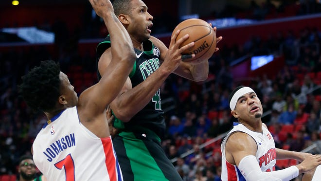 Celtics forward Al Horford drives against Pistons forward Stanley Johnson in the first half Sunday at Little Caesars Arena.