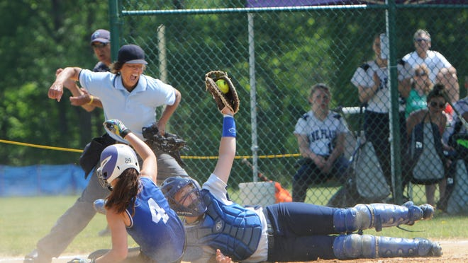 Chester High School's Skylar Conklin gets called out at home as Pine Plains catcher Cathryn Simmons shows the ball during the Section 9 Class C Championship held at Rhinebeck on Saturday.