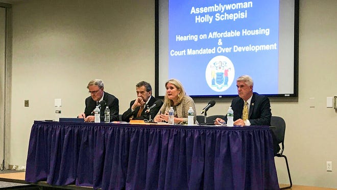 "A public hearing in Paramus on mandated affordable housing Thursday, June 15, 2017.  From left, Assemblyman Robert Auth, state Senator Gerry Cardinale, Assemblywoman Holly Schepisi, and Assemblyman Kevin Rooney.   Assemblywoman Holly Schepisi and other state officials that the analysis leading to the obligations was ""ridiculous"" and ""stupid."" The obligations were created by the Cherry Hill-based Fair Share Housing Center."