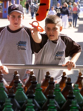 1999: Toms River East American Little Leaguer Jeff Burgdorf (left) watches Mike Casale try to win at Wild Ring Fling at Six Flags Great Adventure in Jackson Monday afternoon. The team was treated to a day at the park.
