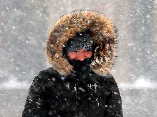 A woman walks in blowing snow in downtown Boston, Thursday, Jan. 4, 2018. A massive winter storm swept from the Carolinas to Maine on Thursday, dumping snow along the coast and bringing strong winds that will usher in possible record-breaking cold. (AP Photo/Michael Dwyer)
