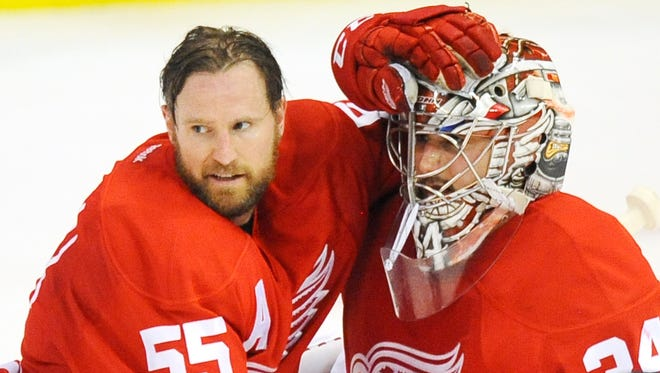 Wings' Niklas Kronwall, left, avoided having surgery on his injured knee due to risk of ending his career.