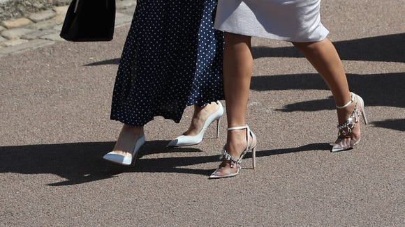Actress Abigail Leigh Spencer and Bollywood actress Priyanka Chopra (right) arrive for the wedding ceremony of Britain's Prince Harry and US actress Meghan Markle on May 19.