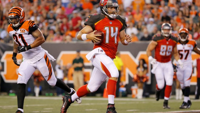 Tampa Bay Buccaneers quarterback Ryan Fitzpatrick (14) strides into the end zone a a QB keeper in the second second quarter of the NFL Preseason Week 1 game between the Cincinnati Bengals and the Tampa Bay Buccaneers at Paul Brown Stadium in downtown Cincinnati on Friday, Aug. 11, 2017. At half time the Buccaneers led 9-6.