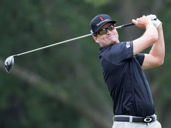 Zach Johnson hits his tee shot on the third hole during