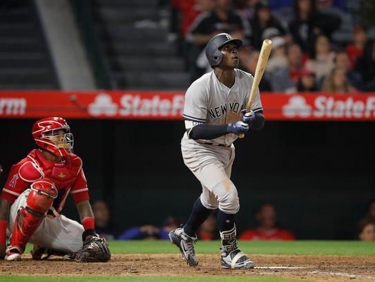New York Yankees' Didi Gregorius watches his home run