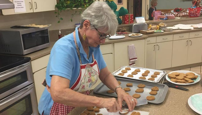 Victoria Shirley prepares peanut butter cookies at the Ronald McDonald House Thursday, Dec. 1, 2016.