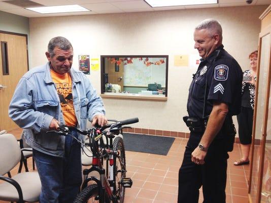 Cop donates bike_01.jpg