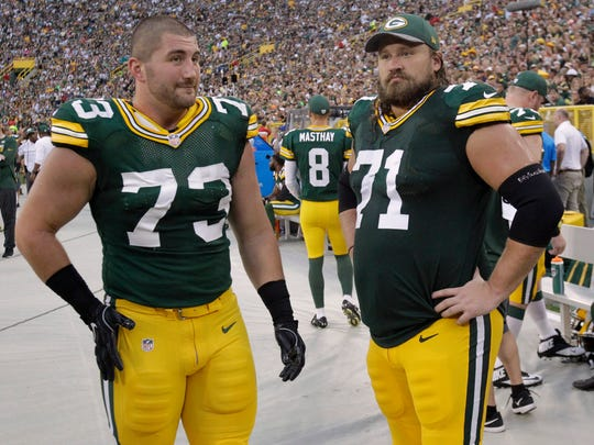 Green Bay Packers center JC Tretter (73) and guard Josh Sitton (71) look on from the sideline against the Cleveland Browns at Lambeau Field.