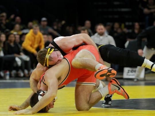 Iowa's Alex Marinelli wrestles Oklahoma State's Chandler