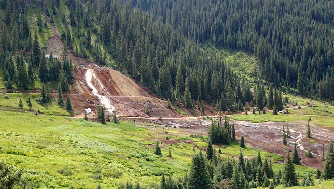 An estimated 300 gallons of water per minute flows out of the Red and Bonita mine site above Silverton, Colo. on Monday, Aug. 10, 2015, as contractors assist the EPA in installing a bulkhead and treatment system.