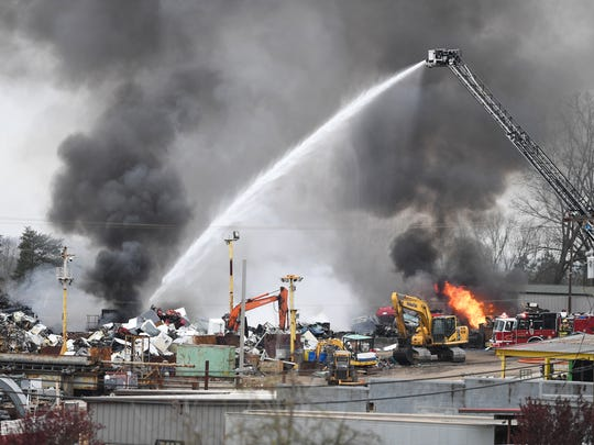 Parker District Fire Department firefighters work a large fire at a scrap metal recycling business that sent plumes of smoke into the sky near White Horse Road.