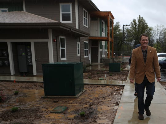 State Sen. Ted Gaines takes a tour of the Woodlands Friday. The facility is a 55-unit development on 9 acres south of the Parkview neighborhood that will serve a mix of working and mentally ill tenants.