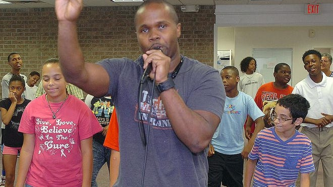 Cupid teaches his latest dance moves to children attending Southern University's Southwest Center for Rural Initiatives summer enrichment program. See a photo gallery at www.dailyworld.com.