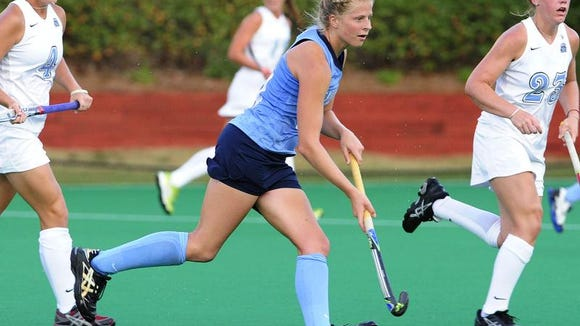 Lakeland graduate Emma Bozek shown in action during her sophomore year at North Carolina-Chapel Hill. (Photos courtesy of the University of North Carolina-Chapel Hill Athletic Department)