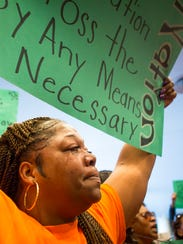 Tears roll down LaTonya Key's cheek, as she and about