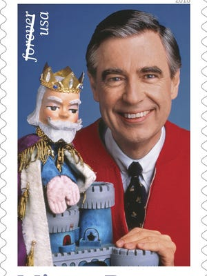 "This image from the U.S. Postal Service shows a stamp featuring Fred Rogers from the PBS children's TV series ""Mister Rogers' Neighborhood"" with his King Friday XIII puppet."