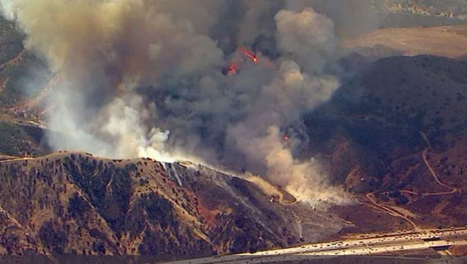 This photo shows the Canyon Fire, which is burning near Highway 91 on the border of Orange and Riverside counties. About 2,000 acres have been burned as of Tuesday.